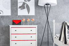 White dresser in grey room Royalty Free Stock Images