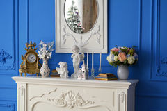 White dresser with mirror reflecting the tree Stock Photography