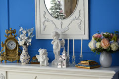 White dresser with mirror reflecting the tree Stock Images