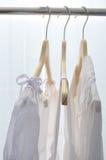 White dresses. In the wardrobe Stock Photos