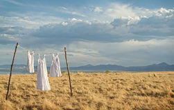 White dresses hanging on a line Royalty Free Stock Photography