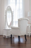 White dressing table and chair with glass miror. At home stock photography