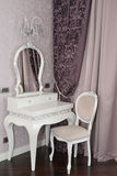 White dressing table and chair in a living room Royalty Free Stock Photography