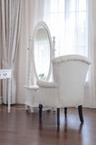 white dressing table with classic chair aand elegance mirror in Royalty Free Stock Image
