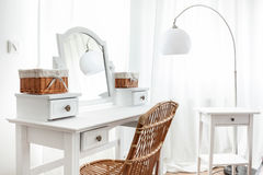 White dressing table with wicker elements. Horizontal royalty free stock photo