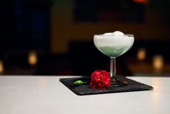 White drink coctail with foam on bar Royalty Free Stock Photos