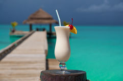 White drink by turquoise sea Royalty Free Stock Images