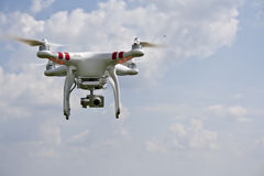 White drone with camera. Drone flying under the sky Stock Photography