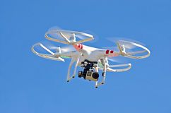 White drone with camera in sky Stock Photography