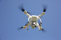 White drone with clear blue sky. White drone with flying in the clear blue sky Stock Photography