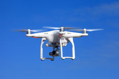 White drone equipped with high resolution 4K video camera Royalty Free Stock Photos