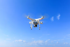 White drone equipped with high resolution 4K video camera Stock Image