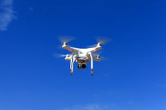 White drone equipped with high resolution 4K video camera Royalty Free Stock Images