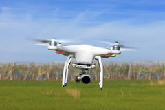 White drone equipped with high resolution 4K video camera Royalty Free Stock Photo