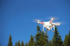 White Drone. Drone flying in the sky Stock Photo