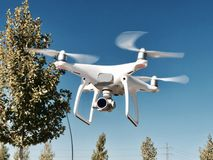 white drone flying royalty free stock photography