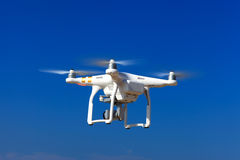 White drone with hovering with blue sky Royalty Free Stock Photography