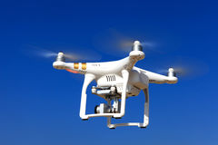 White drone with hovering with blue sky Stock Image