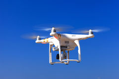 White drone with hovering with blue sky Stock Photos
