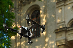 White drone. Hovering near the building Stock Photo
