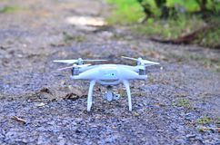 White drone on land rock in morrning for take off take aerial ph. Oto royalty free stock images