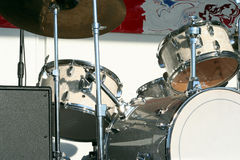 White Drums. A set of white drums sit on stage waiting to be played royalty free stock photography