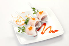 White dumpling trio. Trio of modern Chinese shrimp dumplings or pot stickers on a modern plate with modern garnish and presentation royalty free stock photo