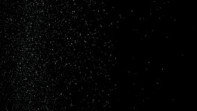 White dust debris exploading on black background, motion powder spray burst in dark texture. Stock footage. Beautiful stock images