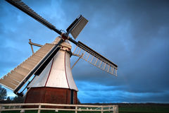 White Dutch windmill in sunset light Stock Photos
