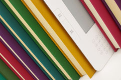 White e book and paper books in a row Royalty Free Stock Photography