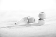 White Ear Bud on White Towel Royalty Free Stock Photo