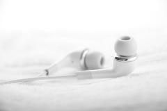 White Ear Bud on White Towel Royalty Free Stock Photo