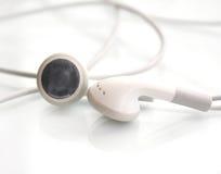 White earphone isolated on white Royalty Free Stock Photos