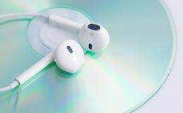 White earphone on music dvd Stock Photo