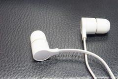 White Earphone Stock Images