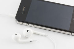 White Earphone and Smartphone equipment set isolated on white ba Stock Photography