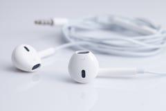 White earphone on white background Stock Photography