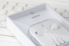 White earphone on white laptop computer Royalty Free Stock Image
