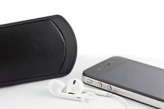 White Earphone , woofer and Smartphone equipment set isolated on Royalty Free Stock Image