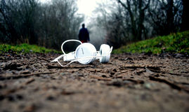 White Earphones on Brown Mud Floor Royalty Free Stock Photography