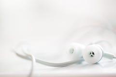 White earphones Royalty Free Stock Photography