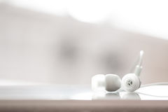 White earphones Royalty Free Stock Photos