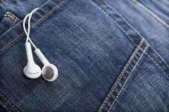 White earphones in denim jeans pocket Stock Photography