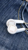 White earphones in denim jeans pocket Royalty Free Stock Photos