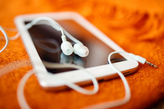 White earphones and tablet pc Stock Photography