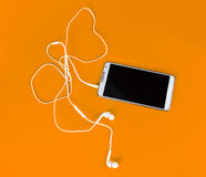 White earphones for using with digital music or  smart phone Royalty Free Stock Photography