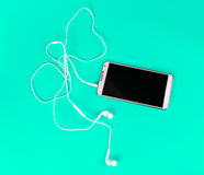 White earphones for using with digital music or  smart phone Royalty Free Stock Image