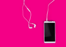 White earphones for using with digital music or  smart phone Royalty Free Stock Photo