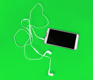 White earphones for using with digital music or  smart phone Stock Photo