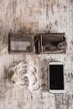 Wallet, smartphone and earphones Stock Photo